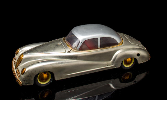 An Alfa-Romeo touring style music box by Ventura toy Co., Italy, c.1950's,