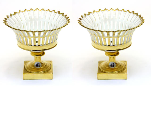 A pair of French porcelain fruit baskets