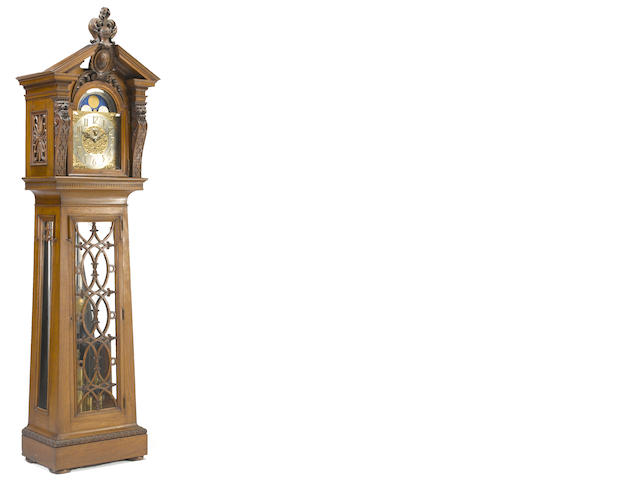 A Baroque style walnut and oak tall case clock, Elliott, London<BR />first half 20th century