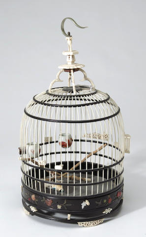 A Chinese bone and wood bird cage