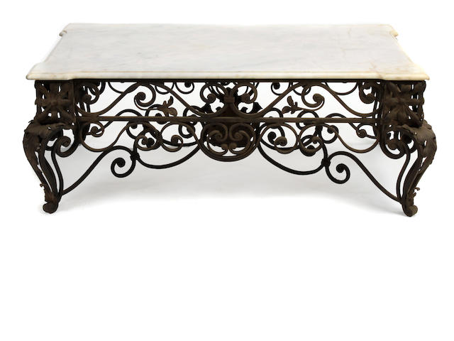 A Rococo style wrought iron and tôle coffee table