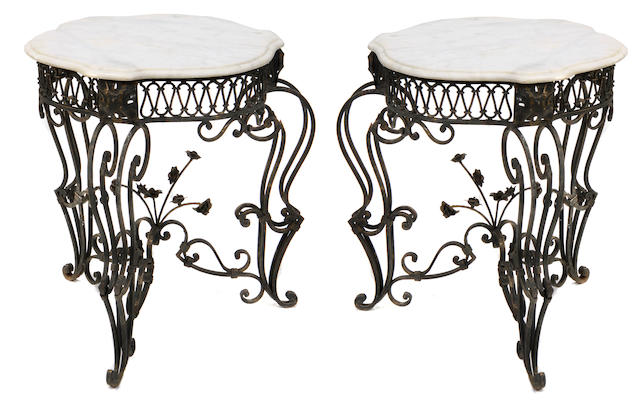 A pair of Victorian style wrought iron and marble tables