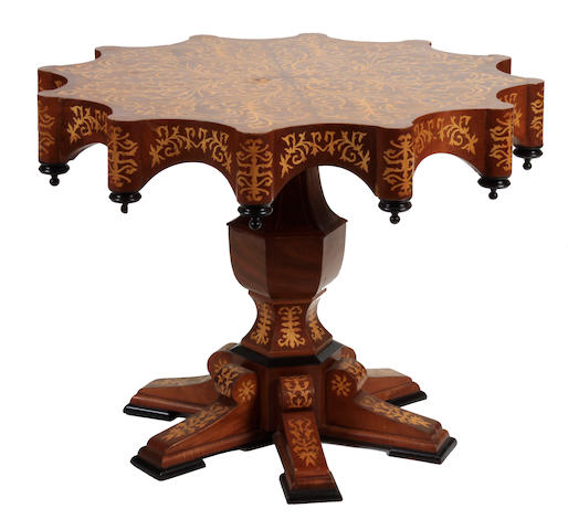 An Italian Renaissance style marquetry center table