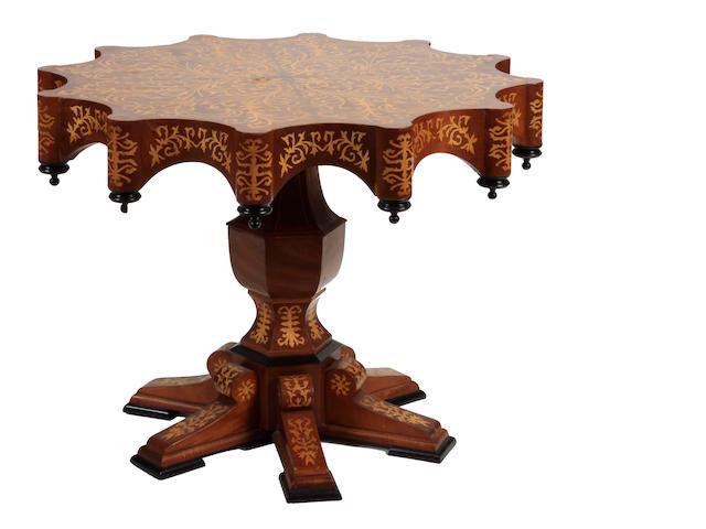 An Italian Renaissance style marquetry center table