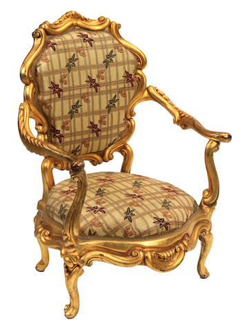 A pair of Italian Rococo style giltwood armchairs