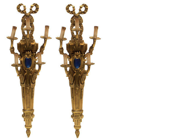 A pair of Louis XVI style gilt bronze five light bras de lumière
