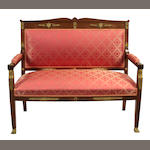 An Empire style table gilt bronze mounted mahogany settee