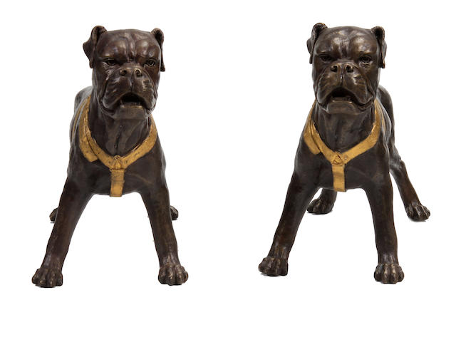 A pair of parcel gilt patinated bronze models of dogs
