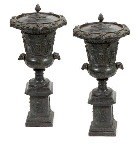 A pair of Neoclassical style covered bronze urns