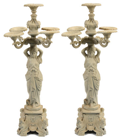 A large pair of Empire style paint decorated cast iron five light candelabra