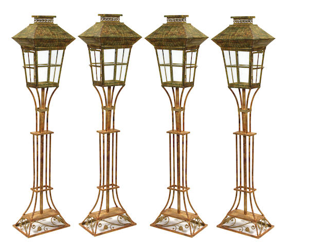 A set of four Victorian style wrought iron and tôle floor lanterns