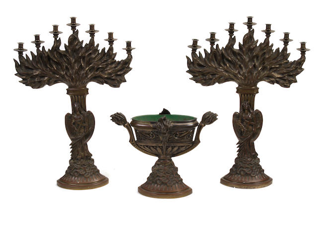 A three piece patinated bronze altar garniture