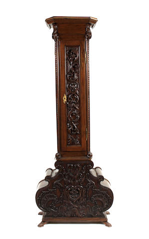 A Continental Rococo style carved oak pedestal cabinet