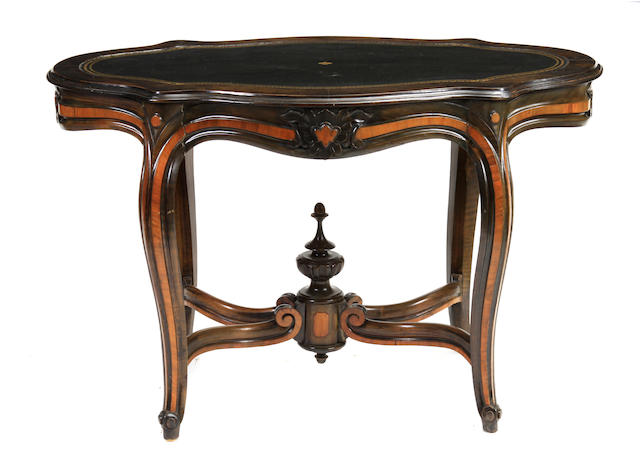 A Victorian mixed wood salon table  with later tooled leather top