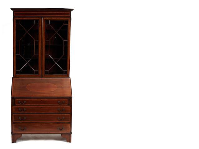 A George III style inlaid mahogany secretary cabinet