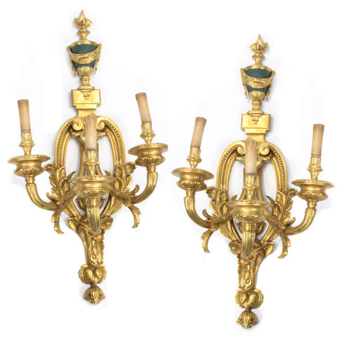 A pair of Louis XVI style gilt bronze three light bras de lumière