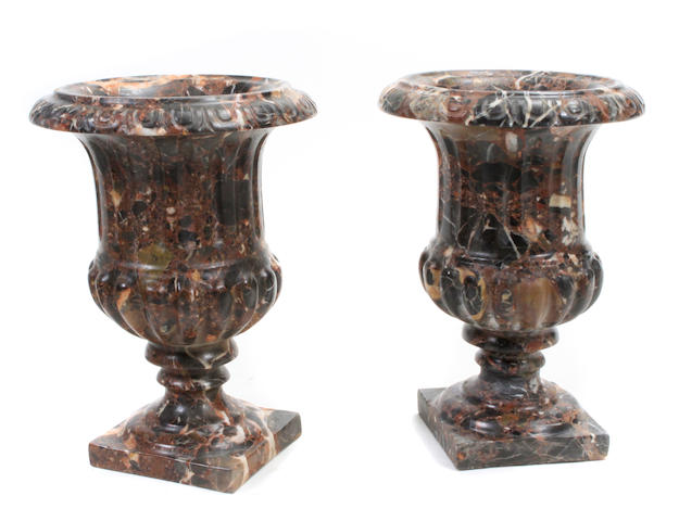 A pair of Baroque style marble campana form urns