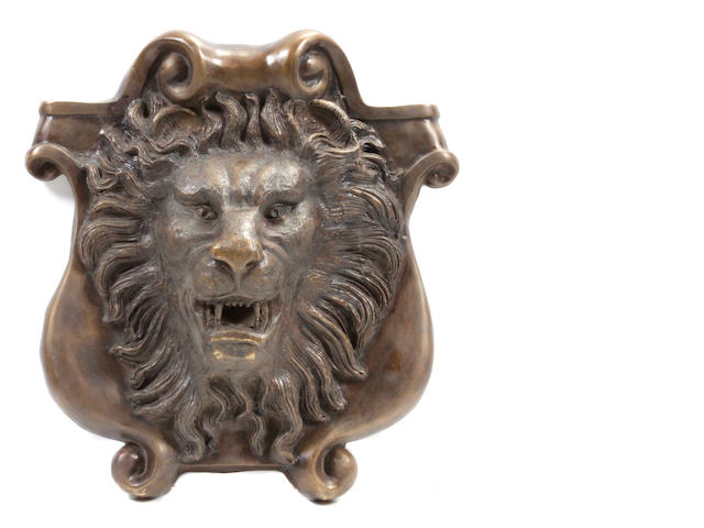 A patinated bronze lion head wall fountain