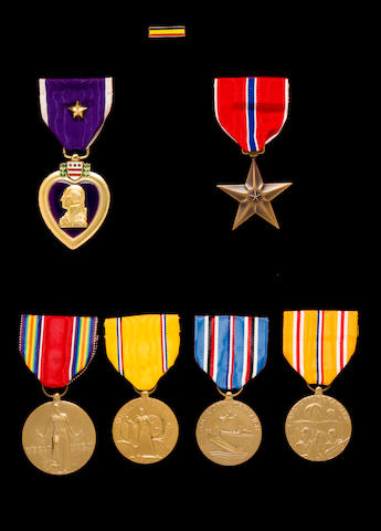 "Rare ""Killed in Action"" Purple Heart won by Marine, Wm. Cuff, killed in action (KIA) on Iwo Jima, together with service record, award docs, and wound documents are in binder"