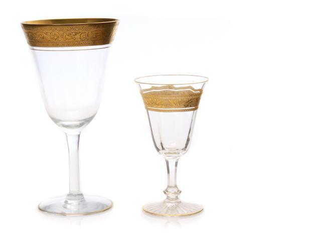 An assembled suite of gilt heightened cut glass stemware