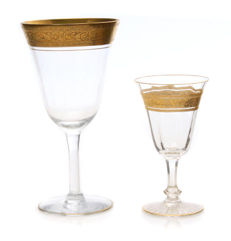 An assembled suite of gilt heightened cut glass stemware