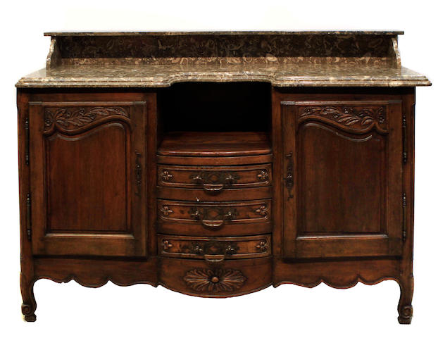 A French Provincial oak and marble buffet