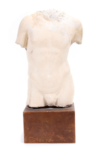 A cast stone torso, after the antique
