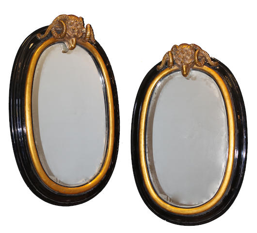 A large pair of Neoclassical style parcel gilt ebonized  mirrors