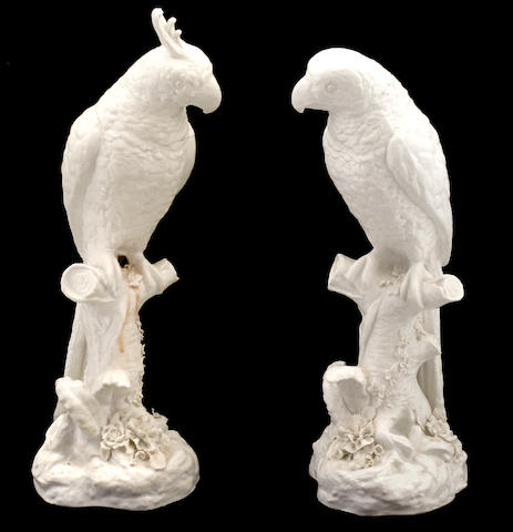 Two French blanc de chine porcelain models of parrots