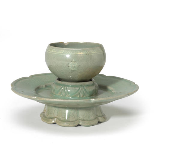 A Korean celadon glazed cup and cup stand 12th century (chip to cup)