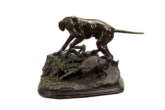 A French patinated bronze animalier group of a spaniel and pheasant