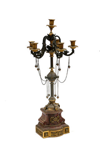 A pair of gilt and patinated bronze and rouge marble six light candelabra
