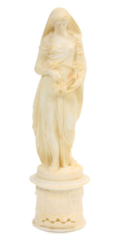 An Italian alabaster sculpture of a classical maiden