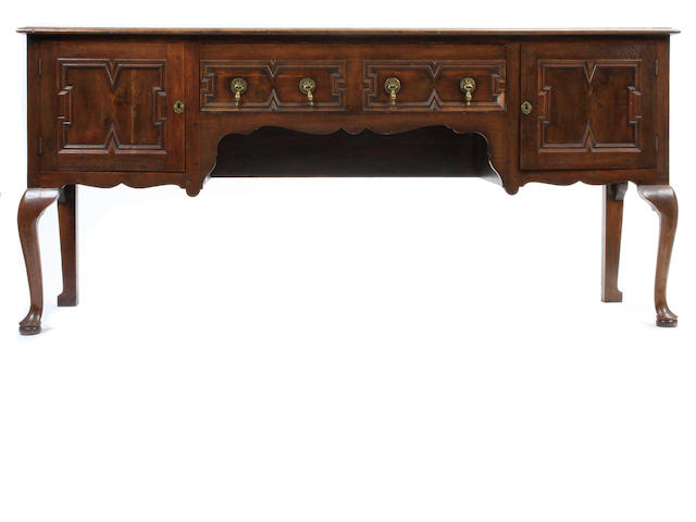 A Jacobean style oak low dresser