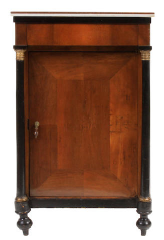 A pair of Continental Neoclassical parcel gilt and ebonized walnut side cupboards