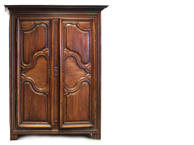 A Louis XV style mixed wood armoire