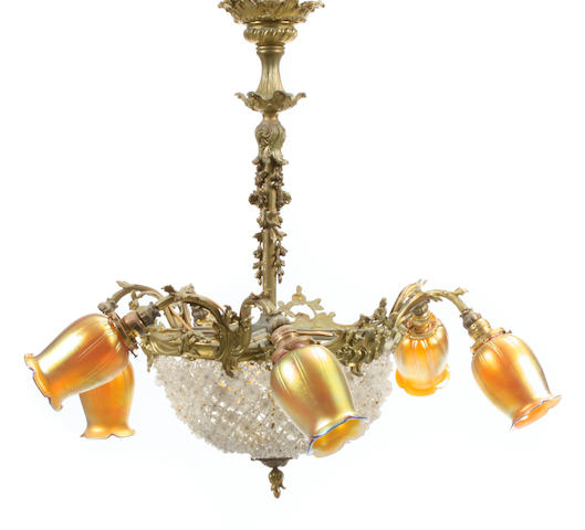 A colored glass six light chandelier with six Lundberg Studios iridescent art glass floriform shades
