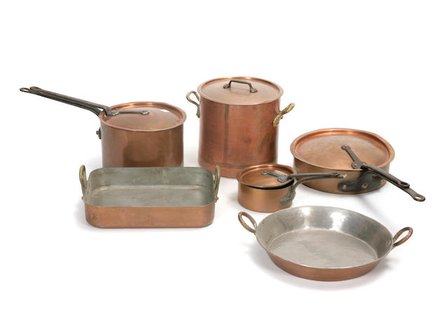 A group of copper cookware items