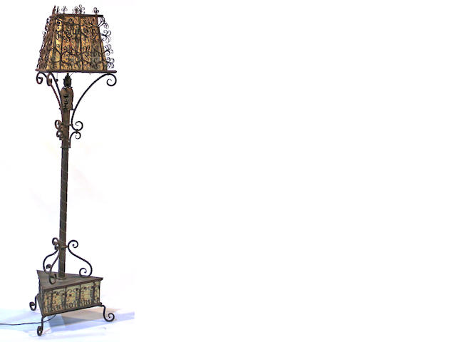 A Renaissance style wrought iron, vellum and tole mounted floor lamp first quarter 20th century