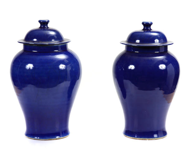 A pair of Chinese blue glazed covered jars