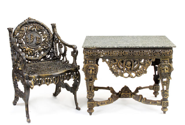 A Victorian style suite of cast iron garden furniture