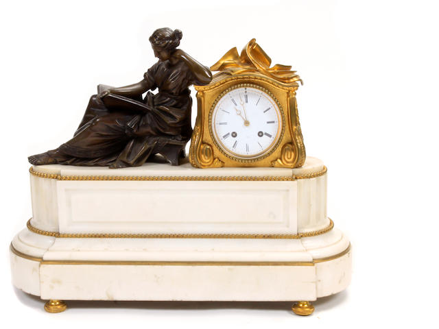 A Neoclassical style gilt bronze and marble mantle clock