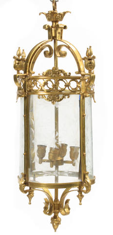 A pair of Regency style gilt bronze and etched glass lanterns