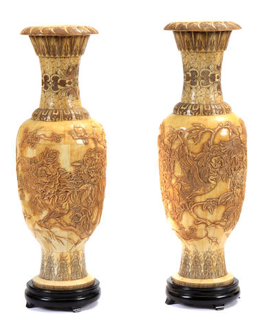 A pair of Chinese bone veneered urns on stands