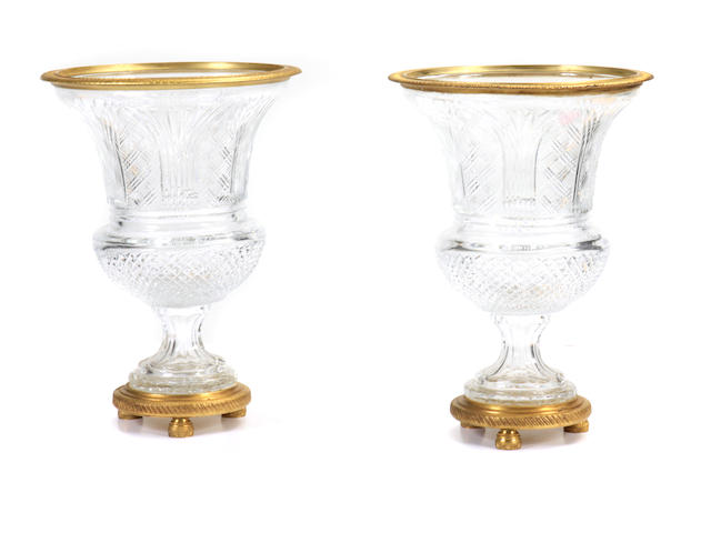 A pair of Neoclassical style gilt bronze mounted cut glass urns