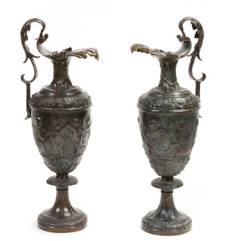 A pair of Reniassance style patinated bronze ewers