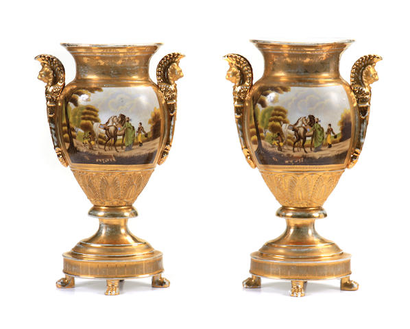 A pair of Paris porcelain style urns