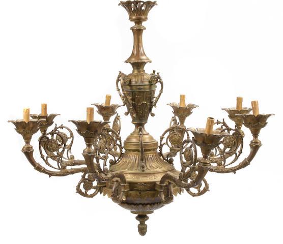 A Regence style gilt bronze eight light chandelier