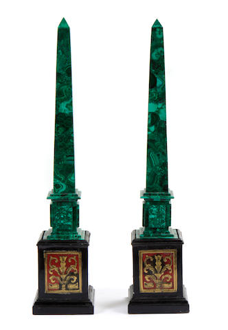 A pair of malachite obelisks on inlaid bases