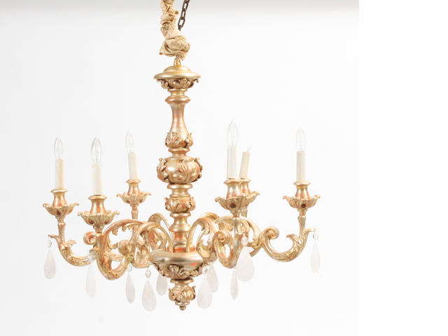 An Italian Rococo style giltwood, glass and rock crystal six light chandelier